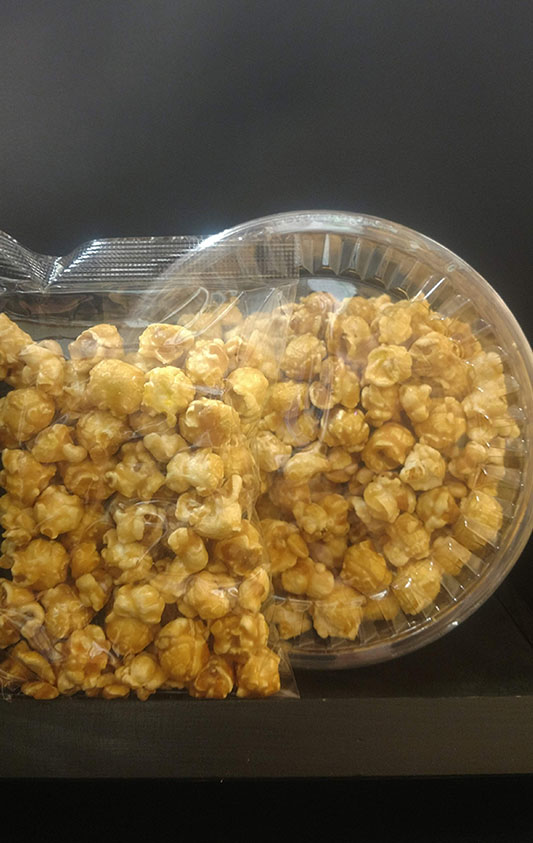 containers of maple popcorn
