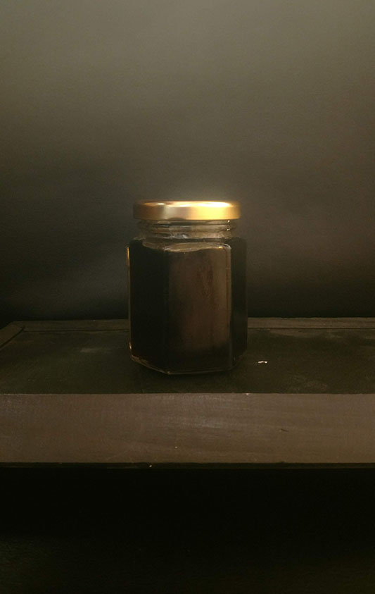 glass jar of maple jelly